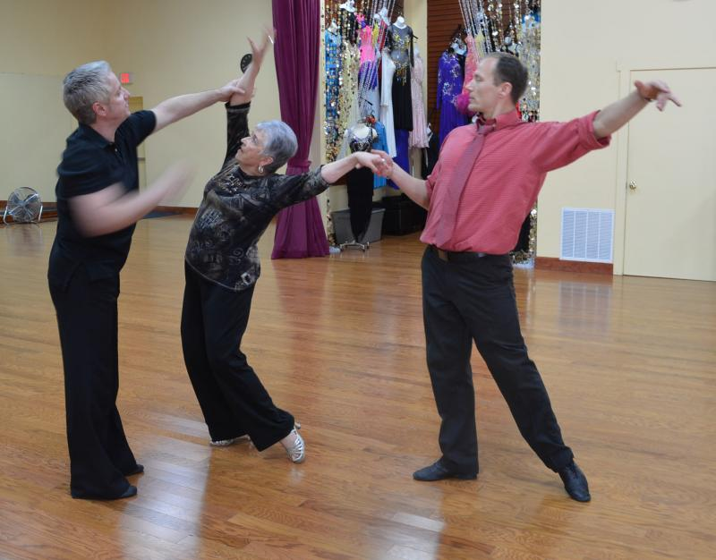 Shepherd and coach/partner Tsyhankov get a master's lesson from world rhythm champion Dan Rutherford (far left). Shepherd and Tsyhankov are competing in the 2013 Cross Country Dancesport Championship in Las Vegas.