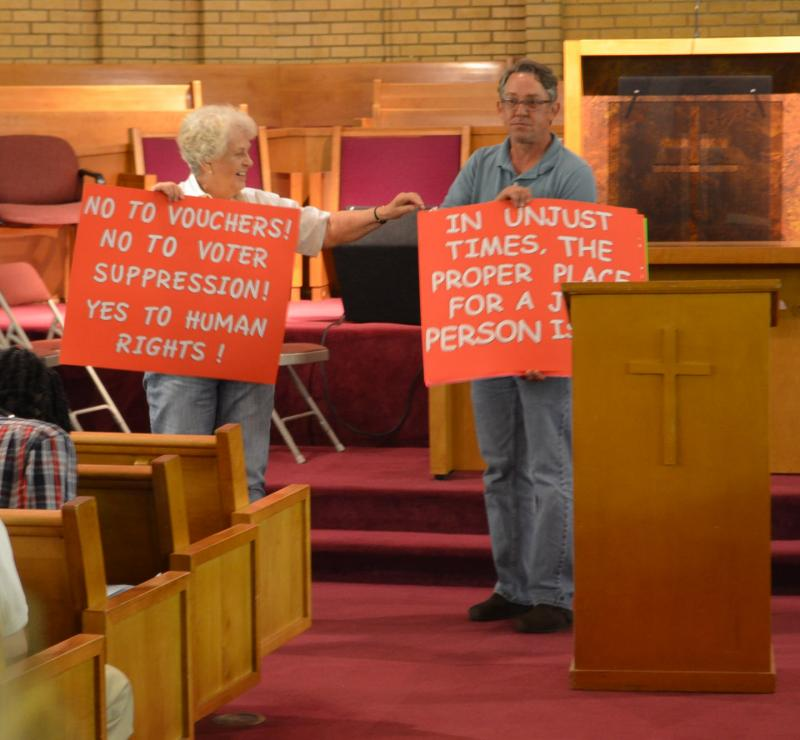 Volunteers display hand-made protest signs in the sanctuary of New Light Baptist Church. The group also raised more than $200 to help pay for the creation of more posters.
