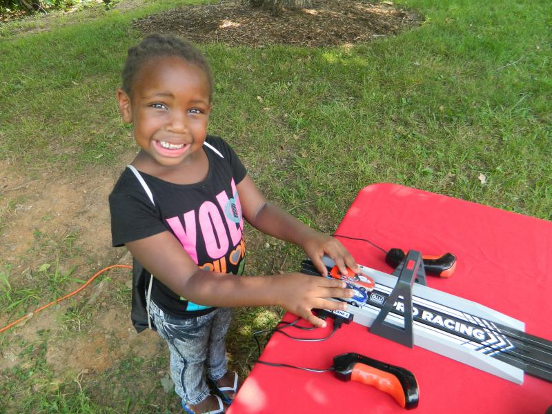 Zykeyua Conrad, 6, of Winston-Salem practices the drag racing game at camp..