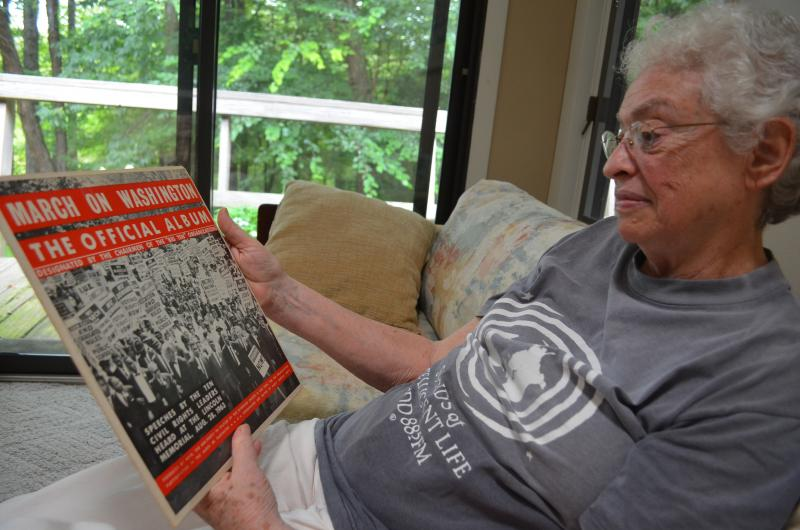 Ellen 'Lennie' Gerber holds the official album from the 1963 March on Washington.