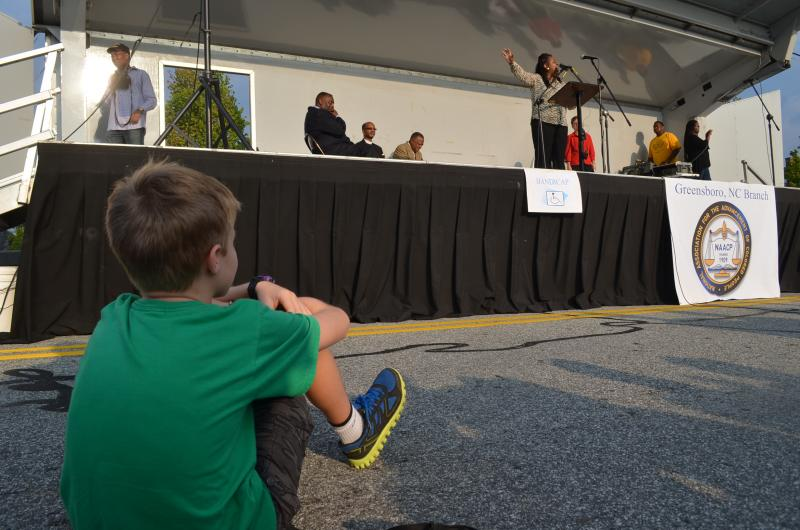10-year-old Nicko Gleason enjoys the speakers and performers. He says the state cuts to education resulted in one of his teachers loosing her job this year.