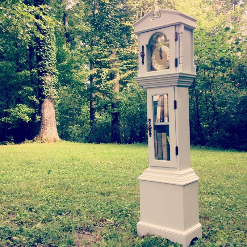 A Little Free Library made by Sarah out of a grandfather clock built by her own great-grandfather.
