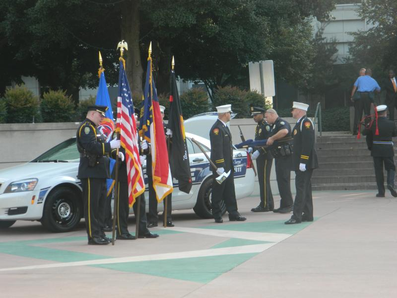 """Members of the Winston-Salem Fire Department Honor Guards prepare for the """"presentation of colors""""."""