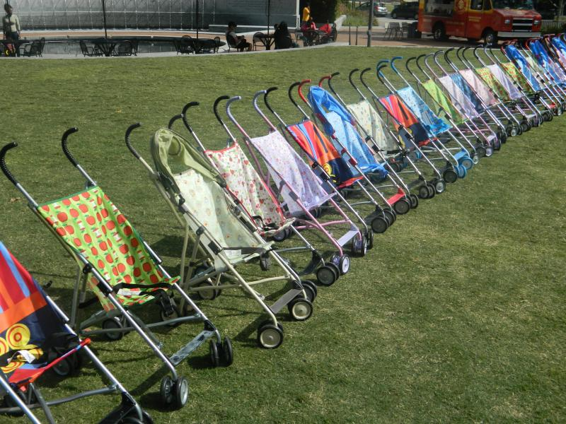 The empty baby strollers represent the 45 infants in Guilford County who died before their first birthday in 2011.