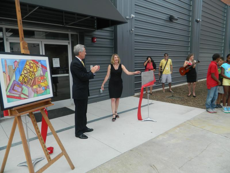 Winston-Salem mayor Allen Joines and school principal Robin Hollis cut the red ribbon to mark the opening of the new middle school building Thursday afternoon.