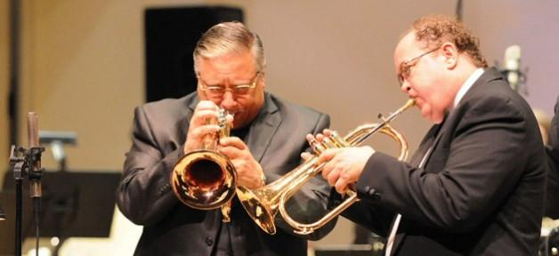 Arturo Sandoval (left) collaborates with a member of the Piedmont Wind Symphony.