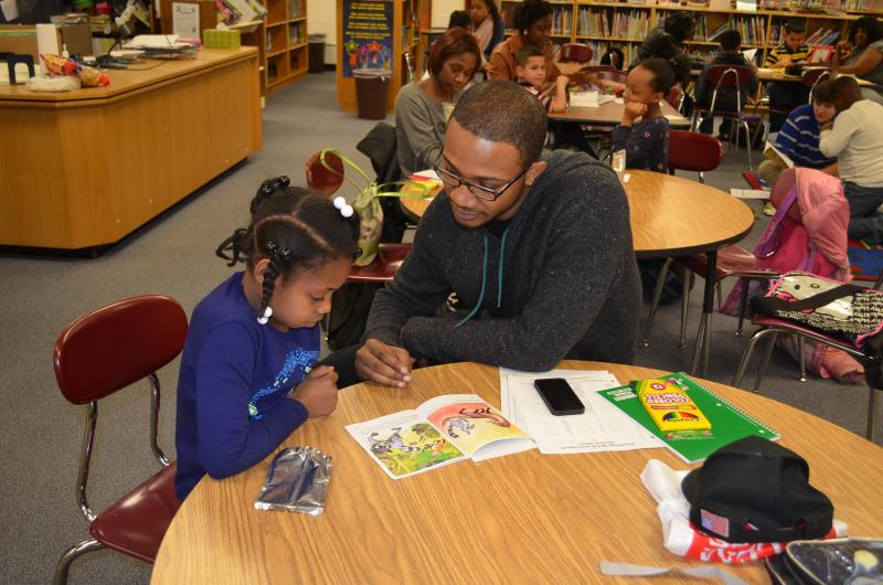WSSU education major Jarrin Wooten (r) tutors first grader Oziah Dean.