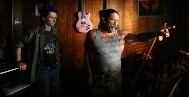 Actor Danny Trejo (center) performs in a scene from the movie, EYEBORGS.