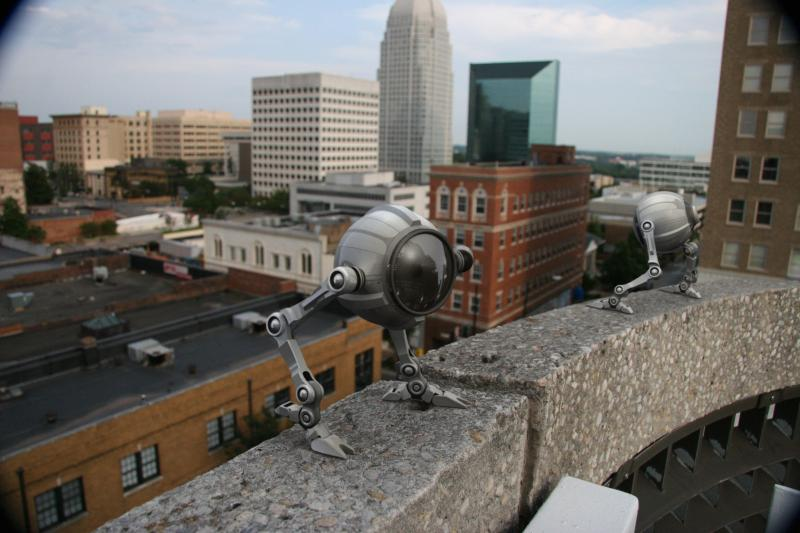 Eyeborg robots on building ledge in Winston-Salem, N.C.