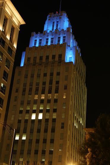 The R.J. Reynolds Building in downtown Winston-Salem shines blue.