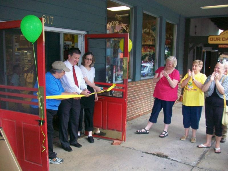2012 ribbon cutting in the old Downtown Boone Drug Pharmacy. (From left to right) F.A.R.M. Cafe Executive Chef Renee Boughman, Boone Drug employees Dale Presnell and Sarah Provost.