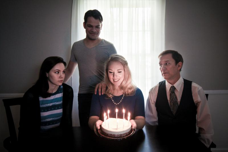 Henson Milam, Heather Hamby, Gray Smith (seated from left to right), and Zach Pfrimmer (standing) portray the Goodman family in a scene from Next to Normal.