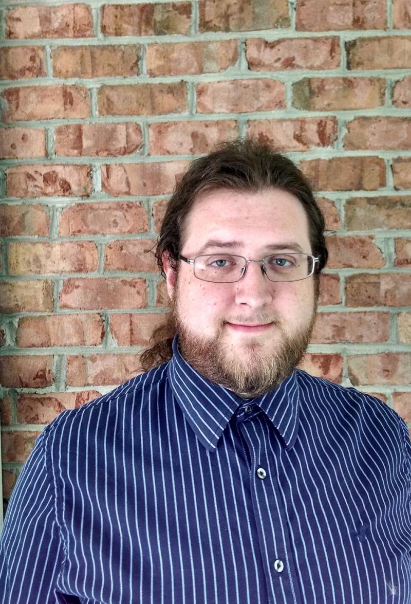 Artist and Gallery Coordinator Bryce Hauser.