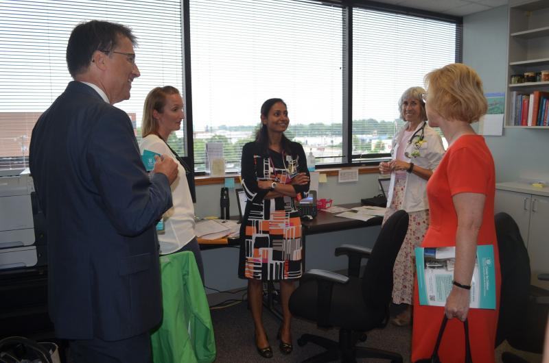 During a tour of the Cone Health Center for Children, Governor Pat McCrory (l) and N.C. Dept. Health and Human Services Secretary Aldona Wos (r) speak with two medical students.