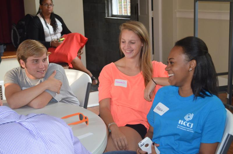 Achaia Dent (r) talks with others who've graduated from the NCCJ ANYTOWN camp.