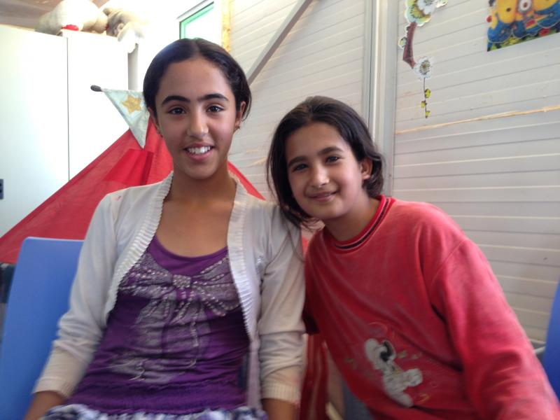 12-year-old Batool (l) and 10-year-old Batool (r) met in Azraq, a second refugee camp in Jordan. They have become fast friends.