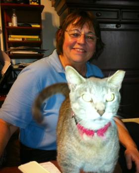 Debbie Rich, former President of Space Coast Feline Network, with one of her 27 cats.