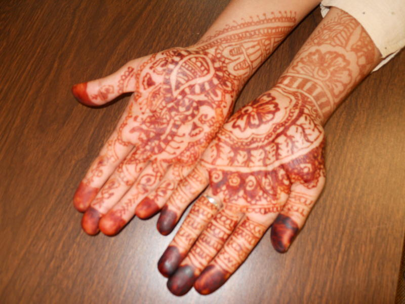 Jaya's henna-painted hands.