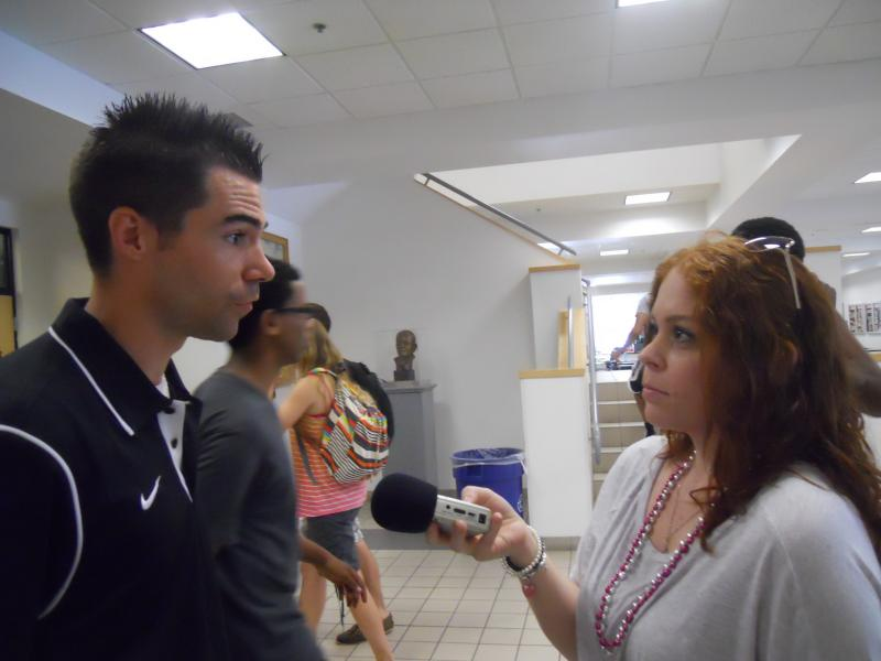 WFIT Communications Intern, Heleni Orjales, talks with Ryan Jones.