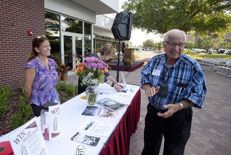 Sonny Marble, host of Classics at Dusk. Volunteer Pam Pedersen at WFIT reception table.