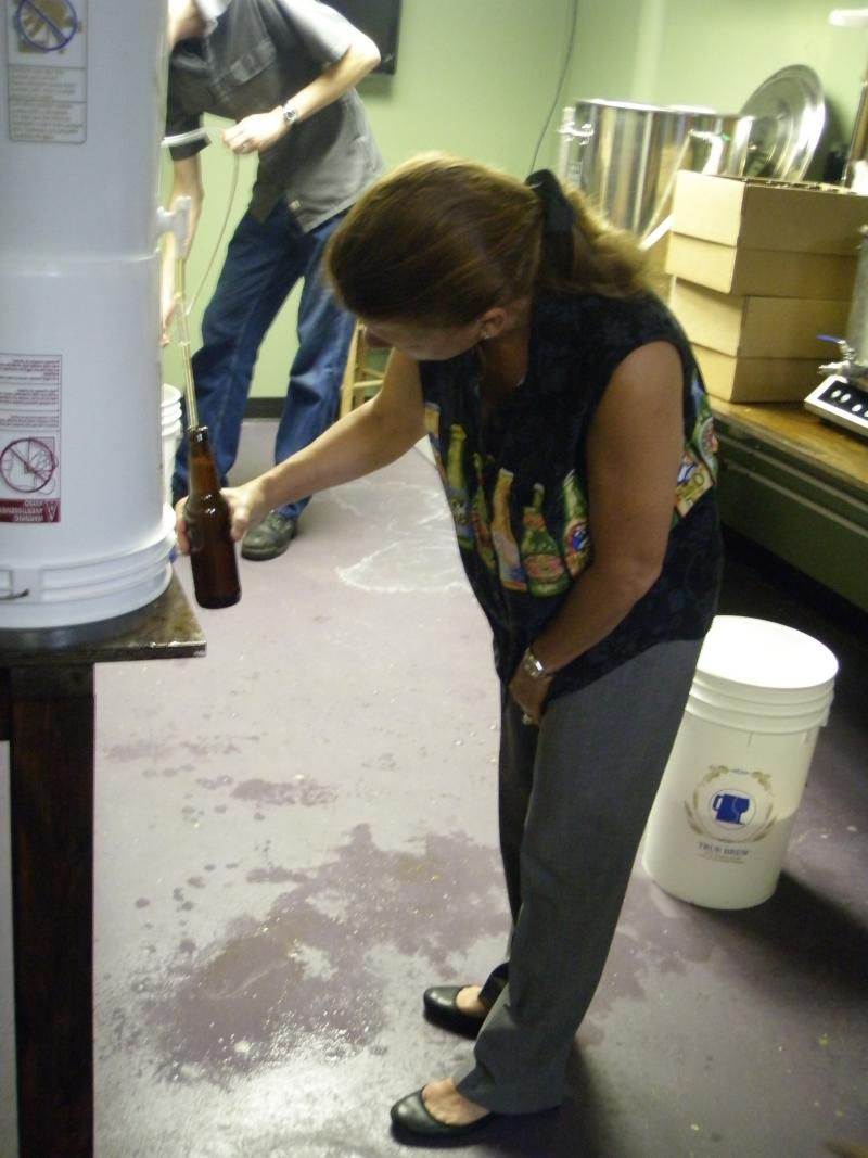 Pam with her beer shirt bottling the brew.