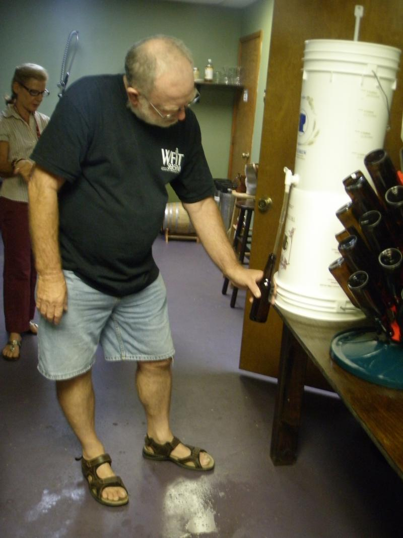 WFIT volunteer Jay Lamy gets into bottling.
