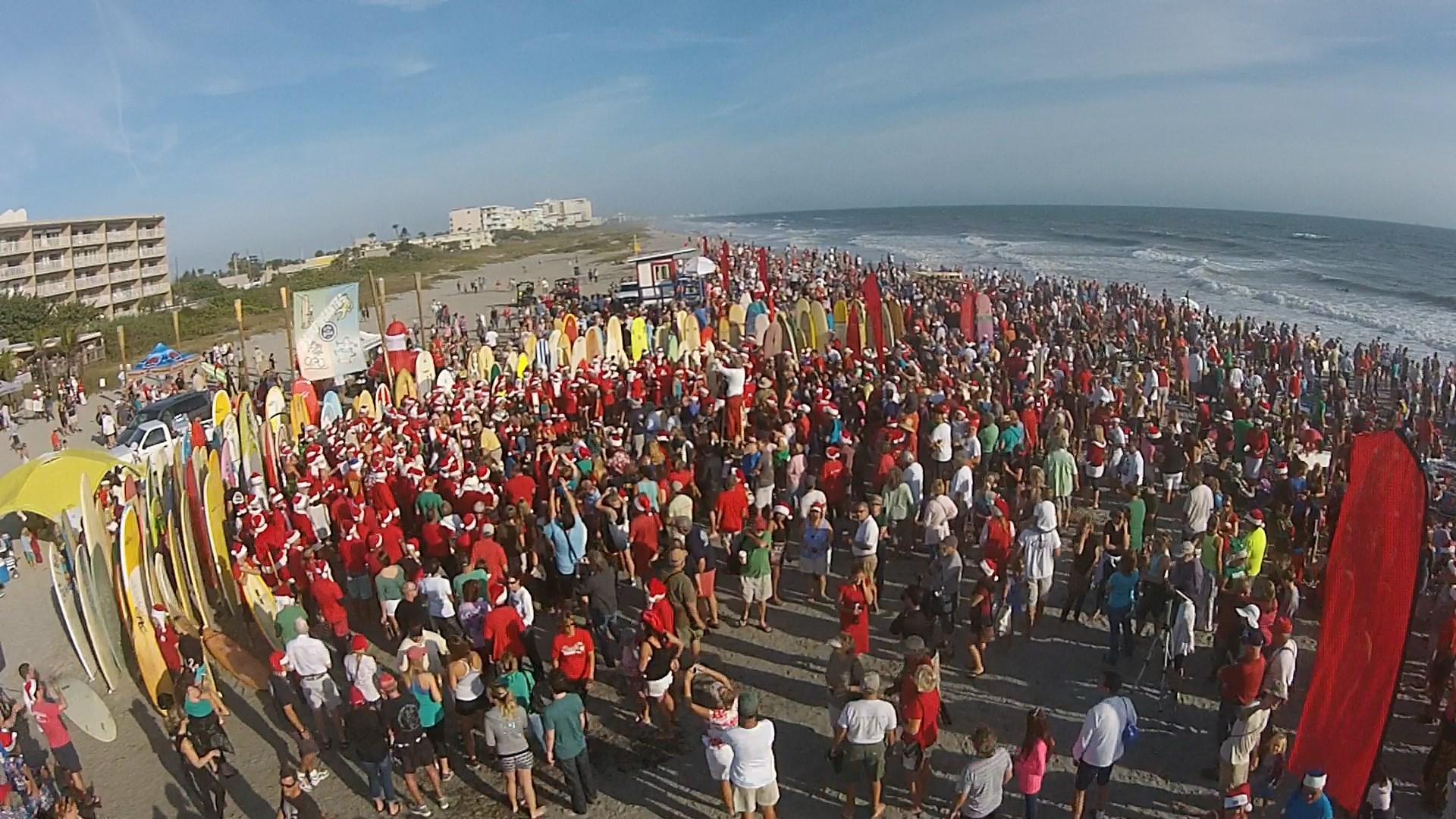 b7ce4c43c08 Surfing Santas Invading Cocoa Beach