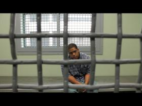 Actor in jail cell