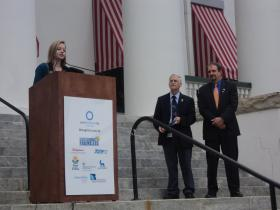 Haley May with Dr. Dennis Cookro, Florida Department of Health's Interim Deputy Secretary for Health, and Diabetes Advisory Council Chairman Chet Evans. They're on the steps of the Capitol to talk about diabetes awareness for World Diabetes Day.