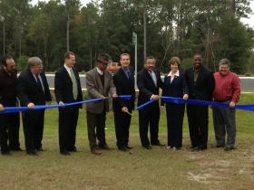 Leon County and City of Tallahassee officials cut the ribbon, reopening Capital Circle Southwest.