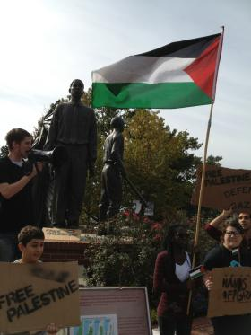 Organizers from Students United for Justice in Palestine rally on Florida State's Integration Statue.