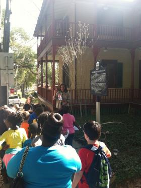 Fourth-graders listen to a presentation outside the John G. Riley House. The tour is part of the 13th annual Blended Lives program.