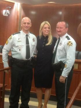 L to R: St. Petersburg Police Sergeant Karl Lounge, Florida Attorney General Pam Bondi, St. Petersburg Police Officer Douglas Weaver