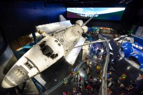 The Atlantis shuttle is the centerpiece of the new $100 million exhibit.