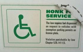 Harding says most gas stations currently have signs like this asking patrons to honk for assistance, but many times, attendants don't hear the honk.