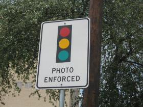 Warning for a red light camera.
