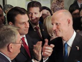 """Senate President Don Gaetz and House Speaker Will Weatherford with Florida Governor Rick Scott during """"Sine Die"""" ceremonies at the close of the 2014 Legislative Session."""