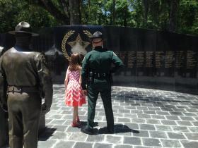 officer looking at memorial wall
