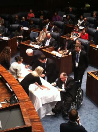 Florida Democratic electors sign election-results certificates in the Florida Senate chambers