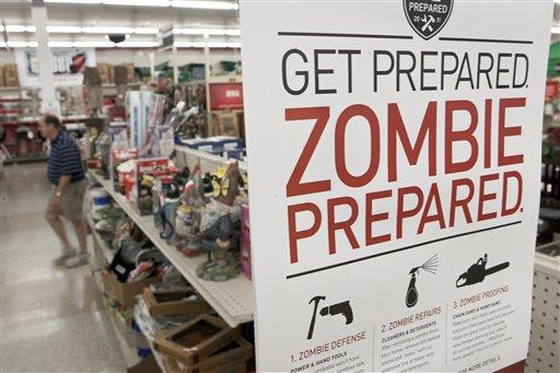 In this Oct. 10, 2011 file photo, a sign promoting zombie preparedness displays in a hardware store in Omaha, Neb.  Several gory incidents have been reported around the country recently, spurring online talk of zombies.