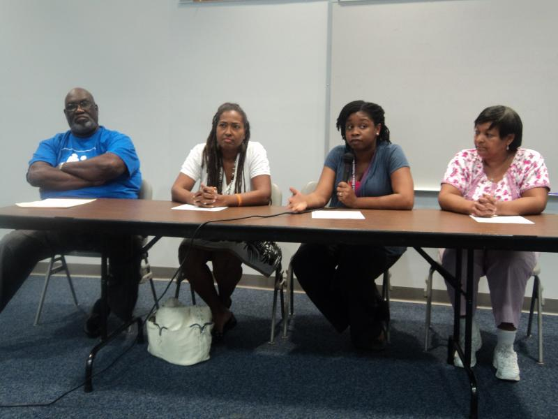 "Panel Members, including Dr. Esaias Lee (far left) and Dykibra Gaskin (talking, second from the right), participating in a panel discussion called ""Why is Breastfeeding so Important?"""