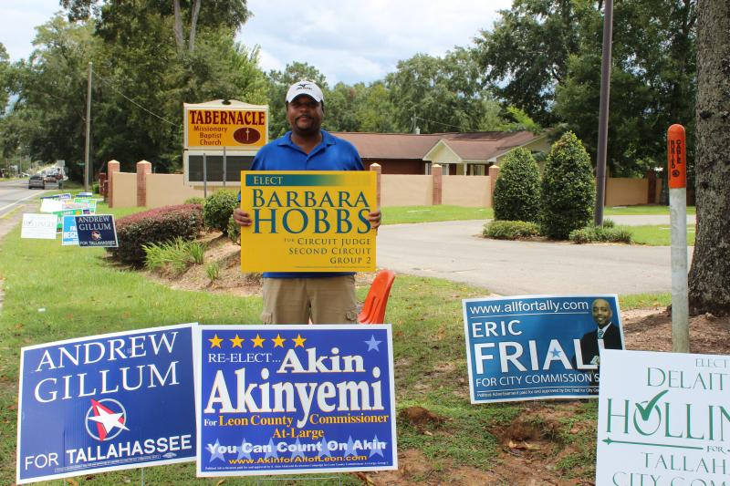 FSU Alumni Kris Hannah shows his support for Barbara Hobbs outside the Precinct 1319 polling station.