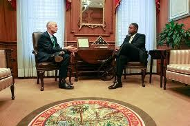 Governor Rick Scott chats with Florida Education Commissioner Gerard Robinson in this undated photo.