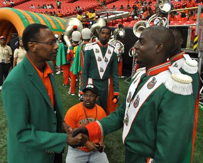 Drum Major Robert Champion (right) shakes former FAMU President James Ammons' hand following the Orlando Classic Football Game in Orlando.