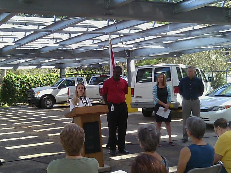 Leon County Office of Resource Stewardship Director Maggie Theriot speaks beneath extension office's new solar grid.