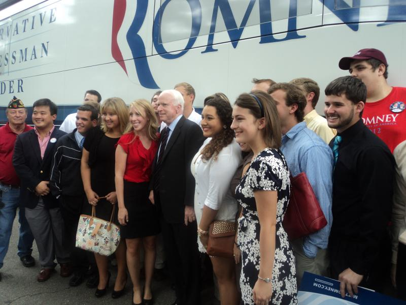 The crowd of people was not only full of vets, it was filled with young people as well. McCain taking a picture outside of the Romney Campaign Bus