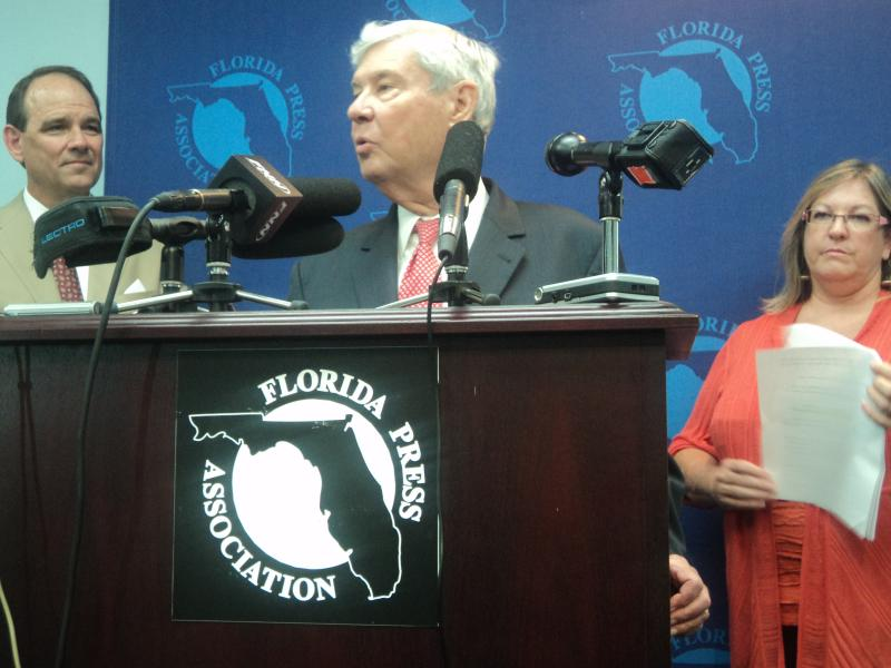 Former Governor Bob Graham talking at the press conference, while former Senator Rick Dantzler and former DEP Secretary Colleen Castille look on