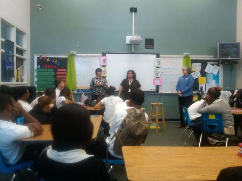 Students at Tallahassee's Ghazvini Learning Center listen as representatives from TCC talk about nursing careers