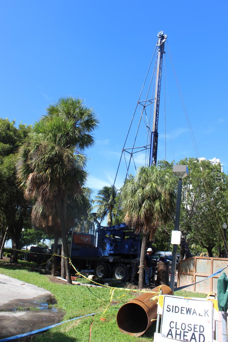 Workers drill to install a new water pump station in Miami Beach. The city has added 17 pumps since 2005, when it only had two pumps.