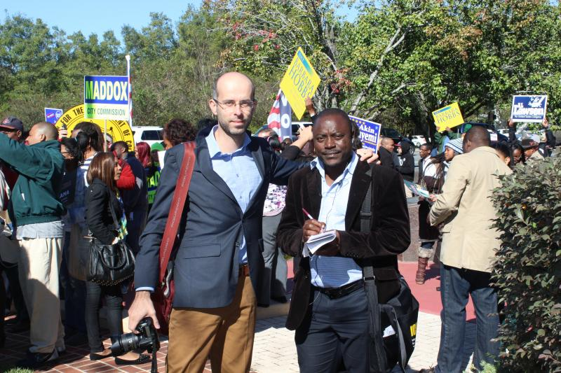 Visiting journalists Konstantin and Ngwane at a get-out-the-vote rally Monday